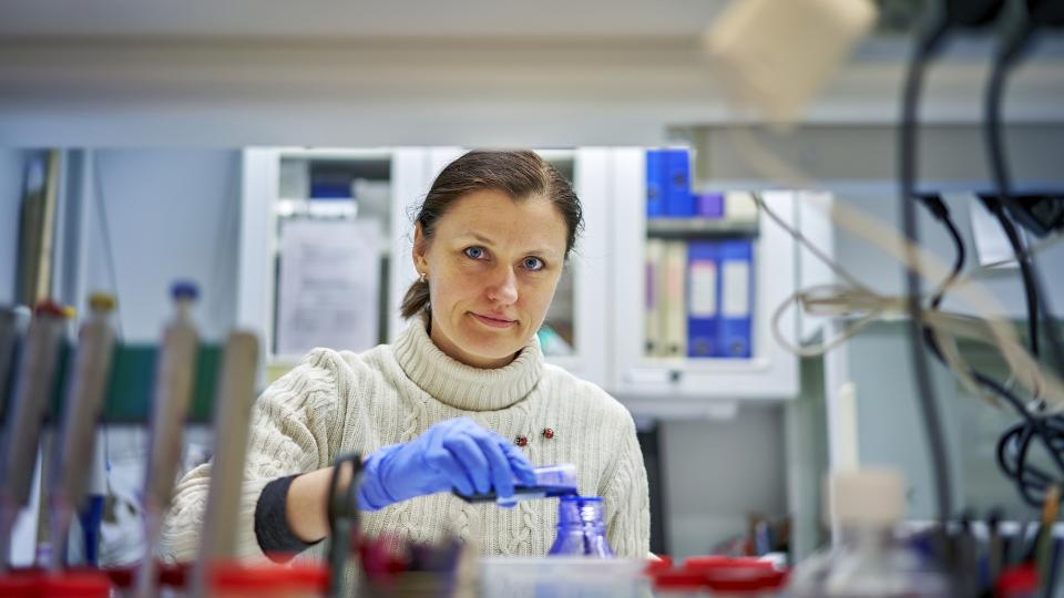 Female Postdoctoral Researcher in laboratory