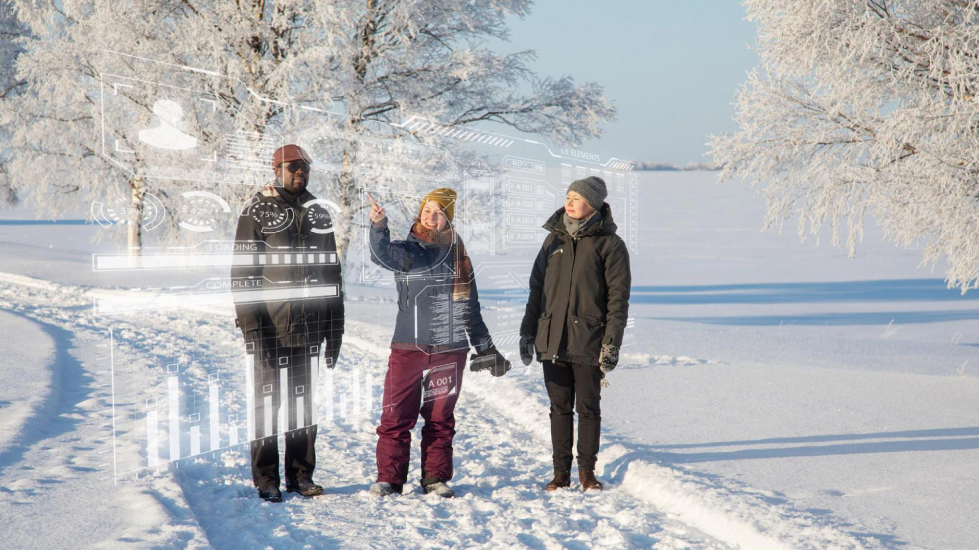 Three people discussing outside in a Northern snowy landscape.